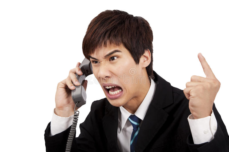 Angry businessman screaming on the phone royalty free stock photography