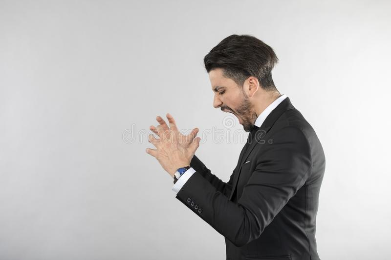 Angry businessman screaming and throwing hands. White background stock images