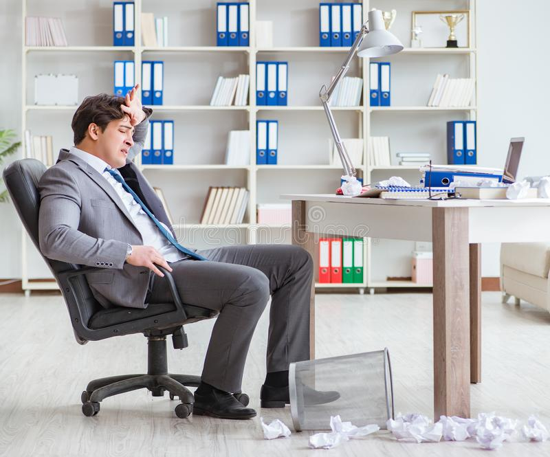 Angry businessman shocked working in the office fired sacked. The angry businessman shocked working in the office fired sacked stock photos