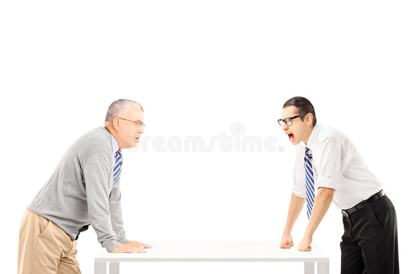 Angry Businessman Shouting At Senior Man Stock Images
