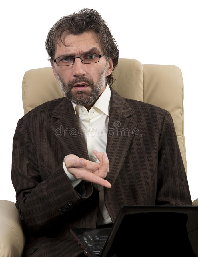 Angry businessman sitting in chair with notebook. Angry businessman in suit sitting in chair with notebook isolated white stock photography