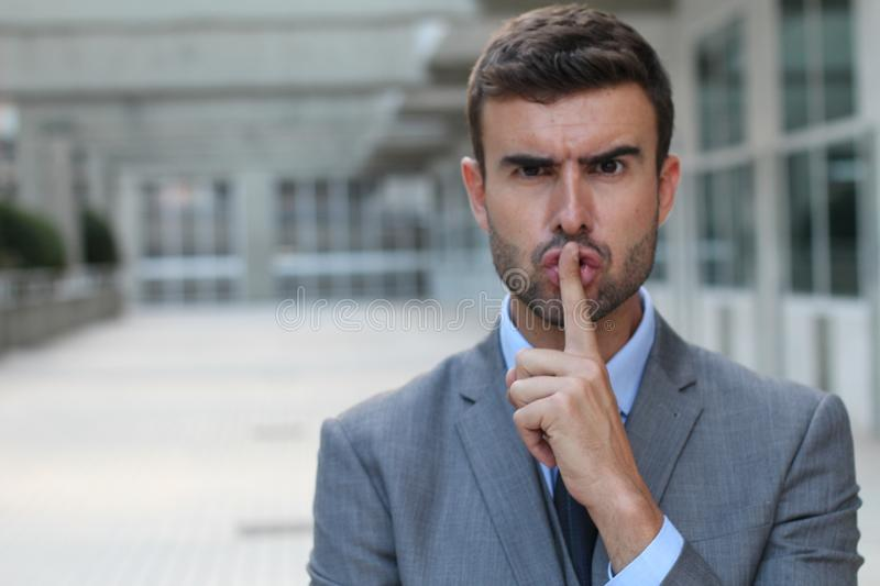 Angry businessman telling you to shut up.  royalty free stock image