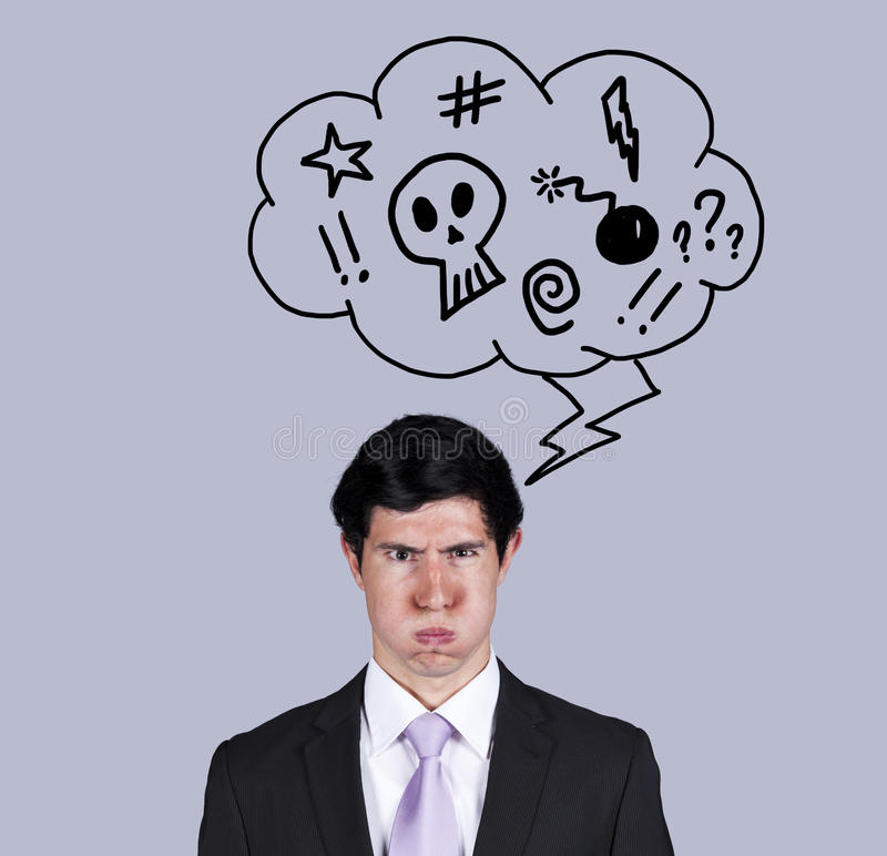Angry businessman thoughts. Furious businessman with a speech balloon with bad thoughts (isolated on gray stock photos