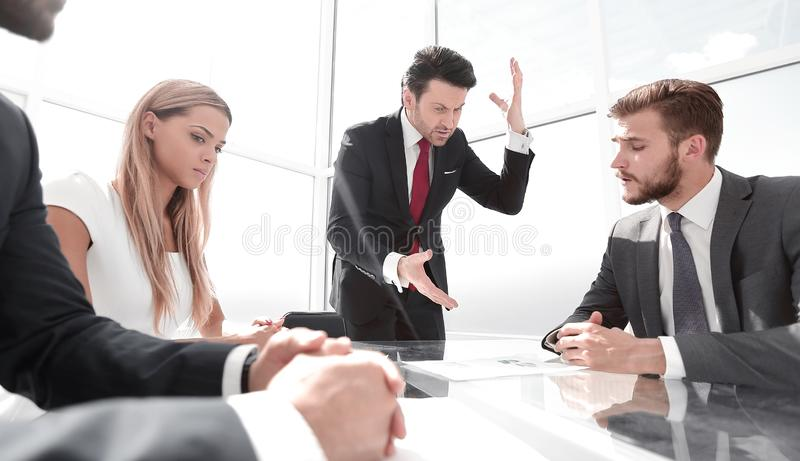 Angry businessman at a working meeting with the business team royalty free stock photo
