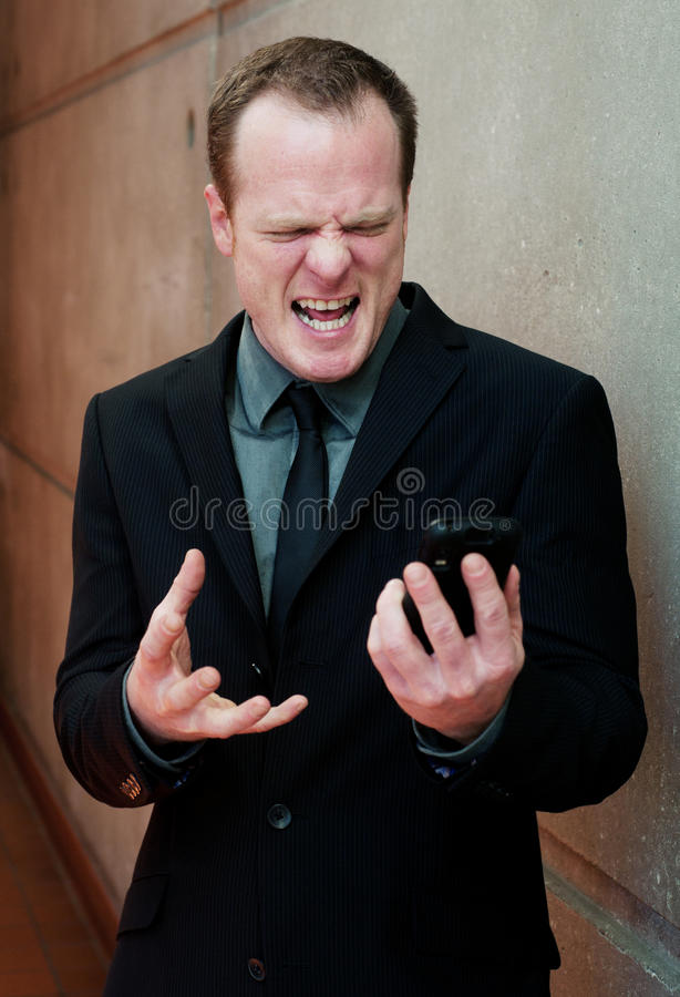 Download Angry Businessman, Yelling At Cell Phone Stock Photo - Image: 24253566