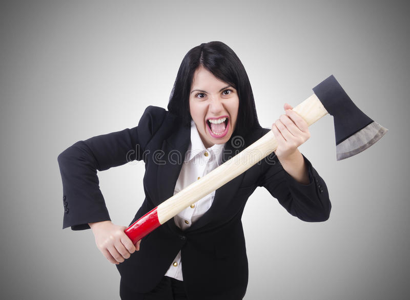 The angry businesswoman with axe on white. Angry businesswoman with axe on white royalty free stock photography