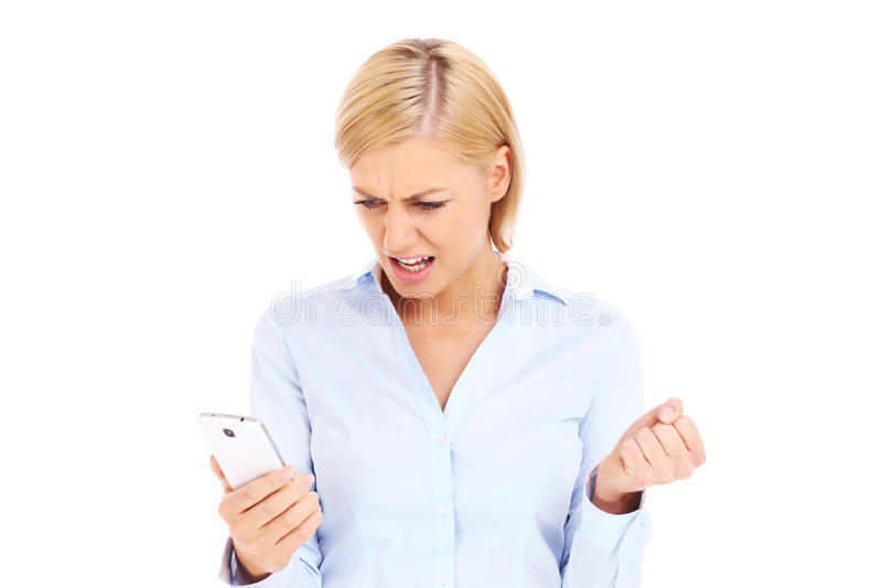 Angry businesswoman with a cellphone stock image