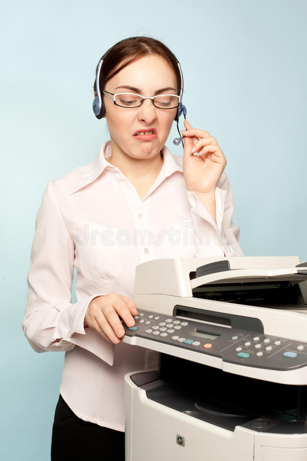 Angry Businesswoman With Copier Royalty Free Stock Photos