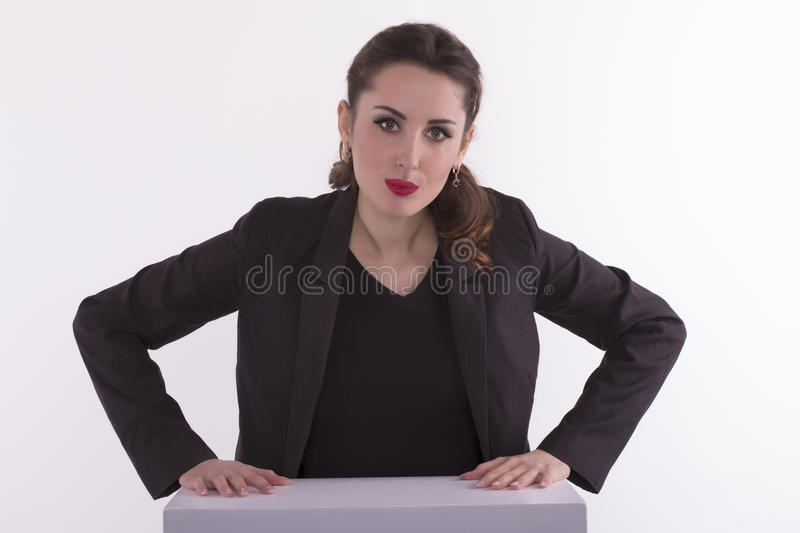 Angry businesswoman at the desk looking at you royalty free stock photos