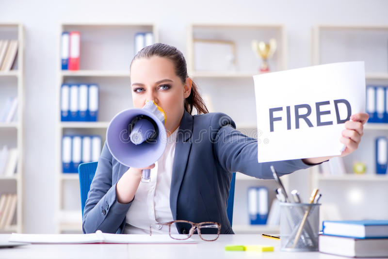 The angry businesswoman issuing termination notice royalty free stock image