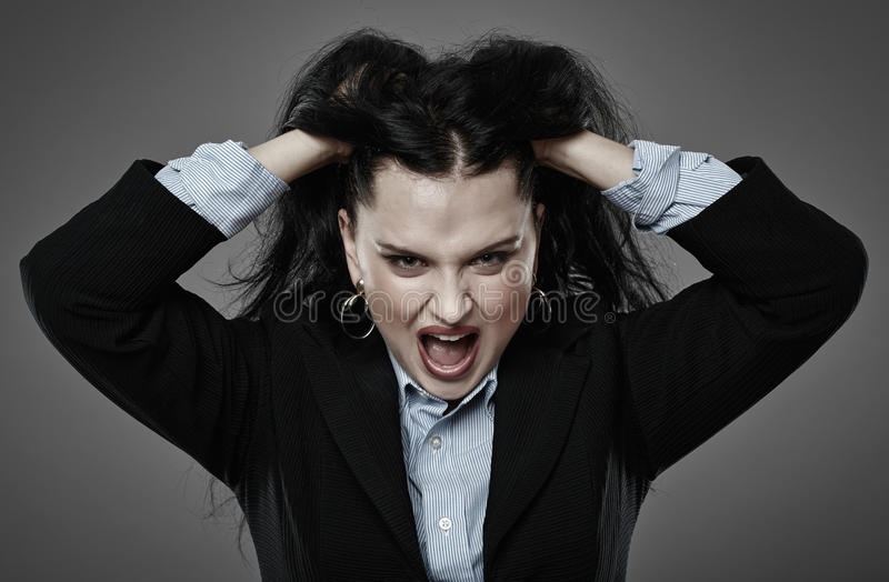 Angry businesswoman shouting royalty free stock photo