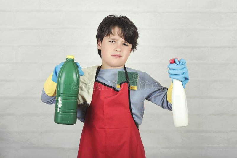 Angry child with cleaning products stock photography