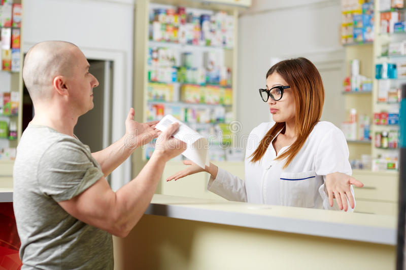 Angry client in a pharmacy royalty free stock image
