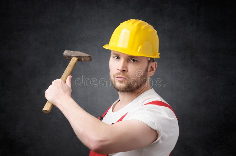 Construction worker with hammer royalty free stock photography