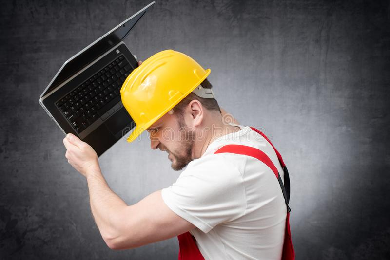 Construction worker with laptop royalty free stock images