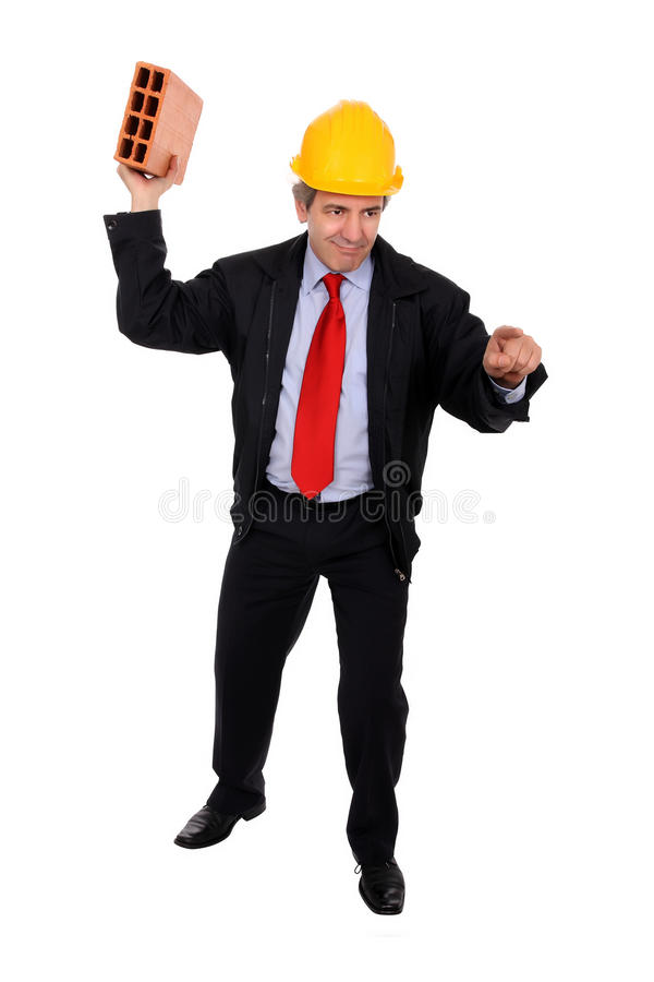 Angry contractor. An angry male contractor ready to throw a brick and pointing royalty free stock images