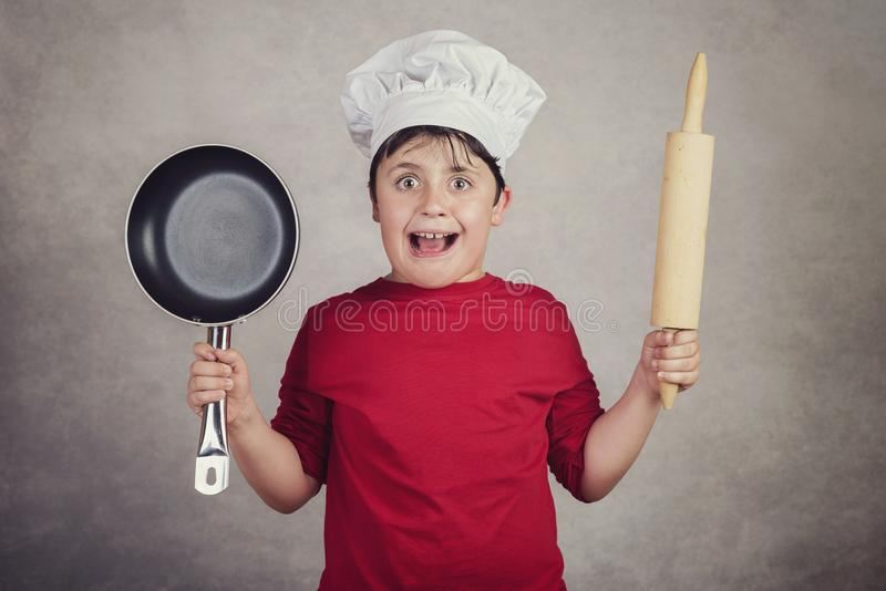 Angry cook child royalty free stock image