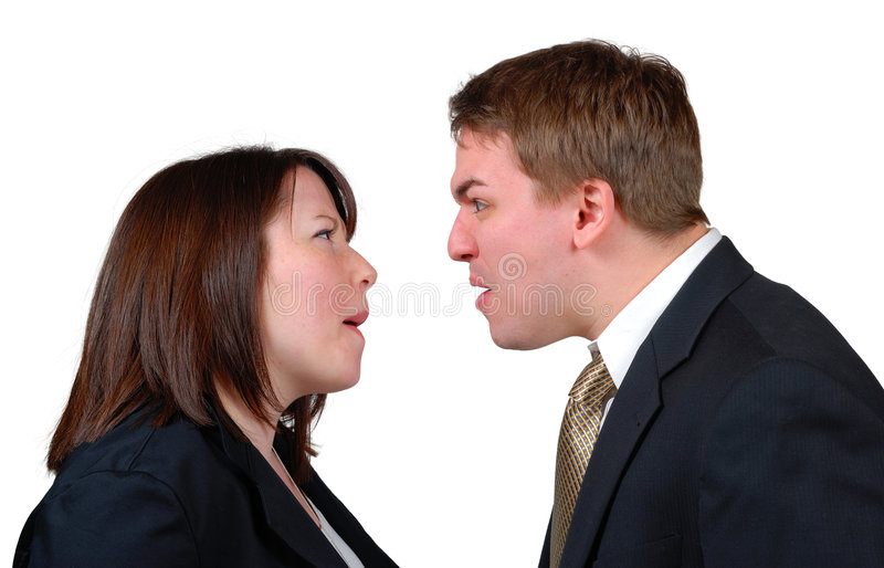 Angry Couple. Man and woman in business attire arguing. Isolated stock image