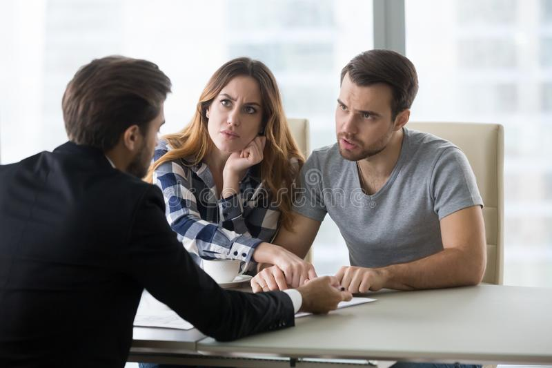 Angry couple arguing meeting lawyer having complaints on bad contract stock images