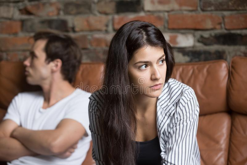 Angry couple avoiding talking after family fight stock image