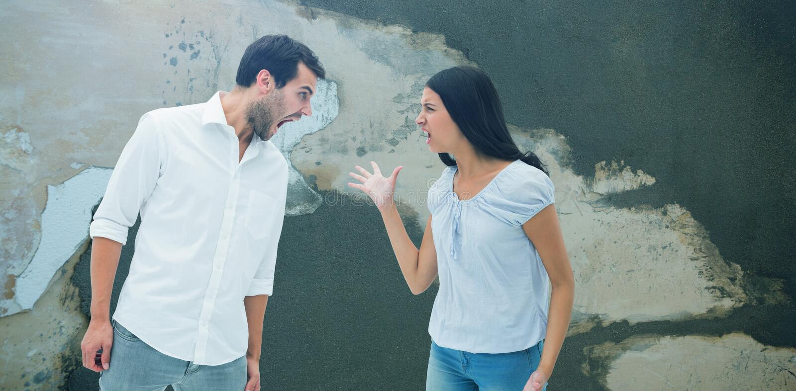 Composite image of angry couple shouting at each other stock photo