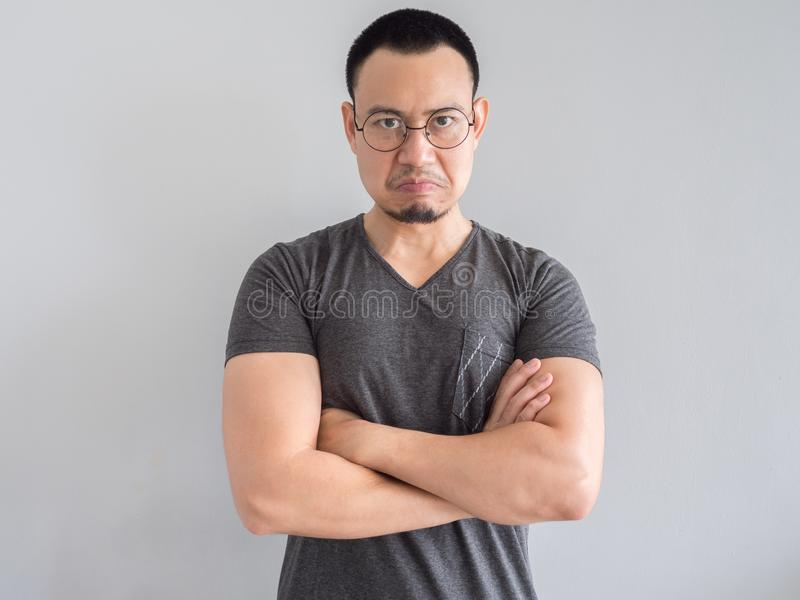 Angry and crazy face of man in black t-shirt. Angry and crazy asian man in black t-shirt and skinhead hair style royalty free stock image