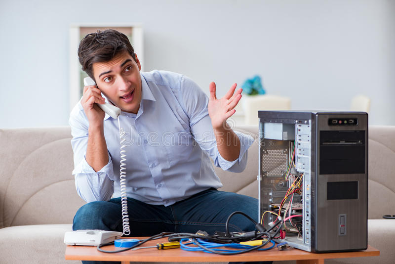 The angry customer trying to repair computer with phone support. Angry customer trying to repair computer with phone support royalty free stock photography