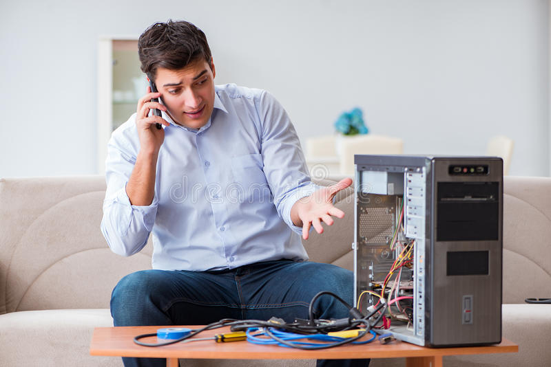 The angry customer trying to repair computer with phone support. Angry customer trying to repair computer with phone support royalty free stock photo
