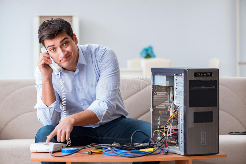 The angry customer trying to repair computer with phone support. Angry customer trying to repair computer with phone support stock photo