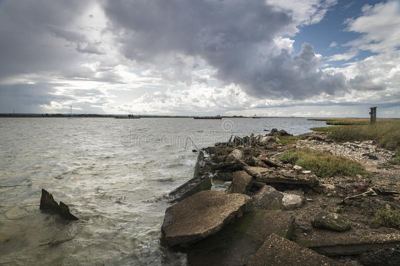 Harty Ferry. Angry dark clouds gathering over Harty Ferry and The Swale on the Isle of Sheppy, Kent, England stock photo