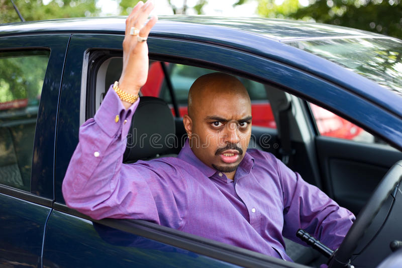 Angry driver. Angry man in his car stock image