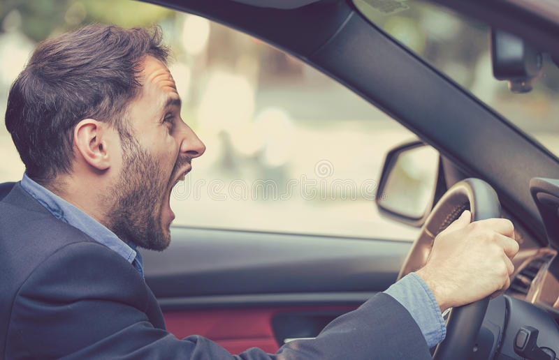 Angry driver. Negative human emotions face expression. Side profile angry driver. Negative human emotions face expression royalty free stock images