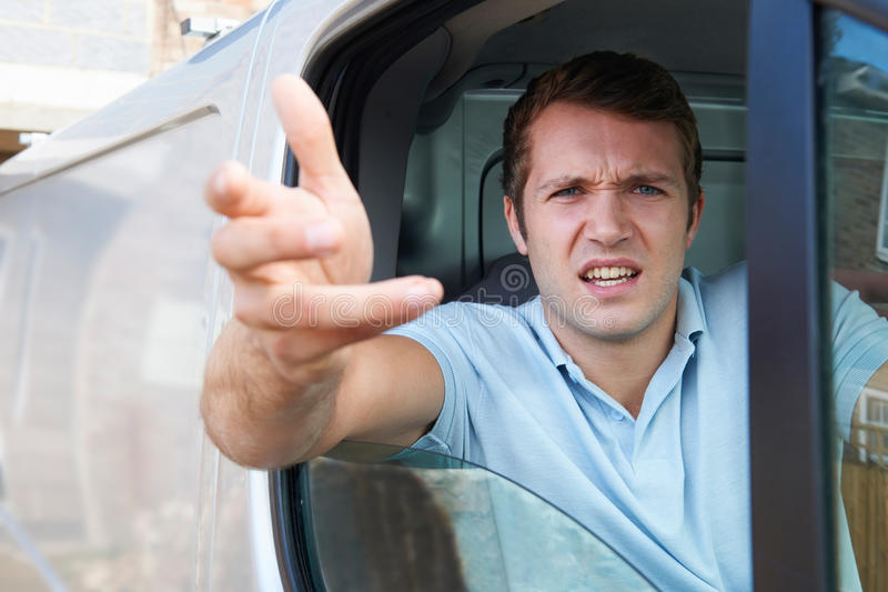 Angry Driver In Van. Gesturing To Camera stock photo
