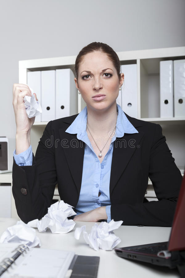 Angry employee crushing paper royalty free stock photo