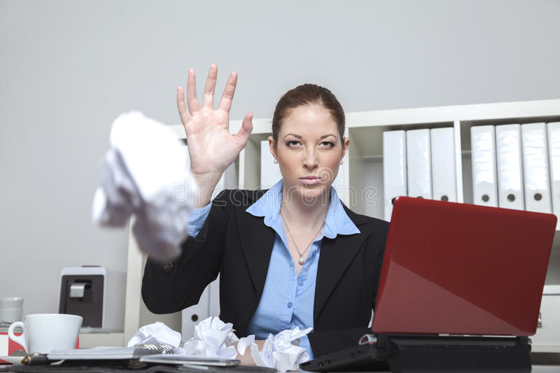 Angry employee crushing paper royalty free stock photography