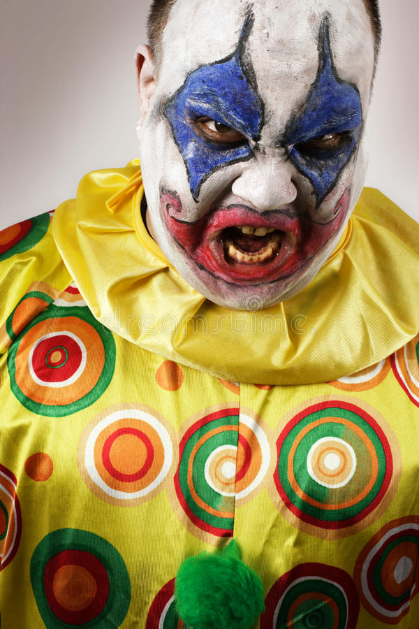 Angry evil clown stock images