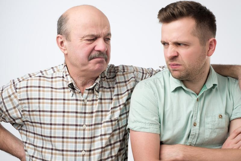 Angry father and son having an argument. Isolated on white background stock images
