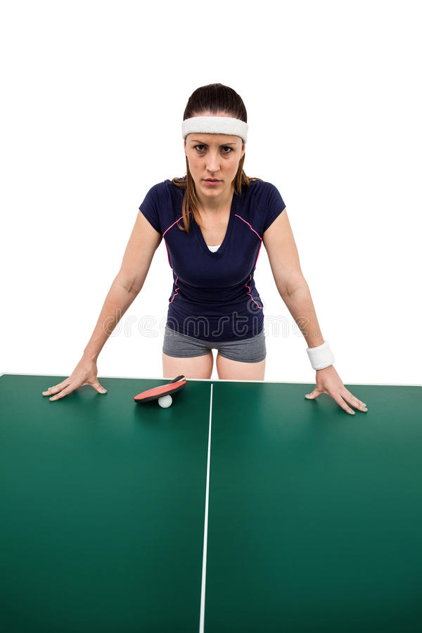 Angry female athlete leaning on hard table royalty free stock images
