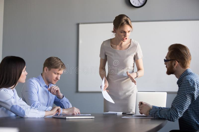 Angry female ceo scolding unprofessional employees for bad work. Angry strict executive, female ceo or team leader scolding unprofessional employees frustrated stock photos