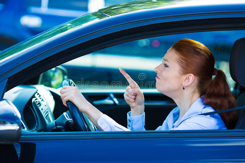 Angry female driver royalty free stock image