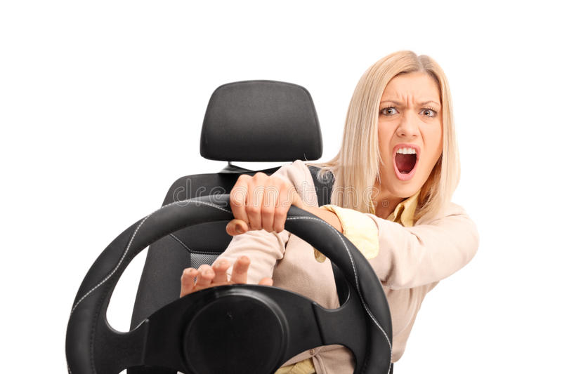 Angry female driver honking on the horn. Angry female driver yelling and honking on the horn isolated on white background royalty free stock photo