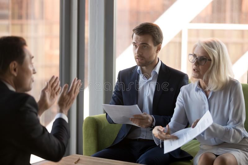 Angry financier director pointing on document showing it to coll. Dissatisfied women financier director criticizing financial report or wrong agreement accusing royalty free stock photos