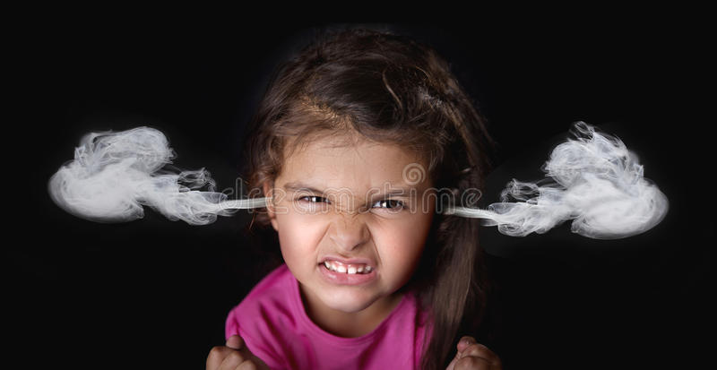 Angry four years girl stock image