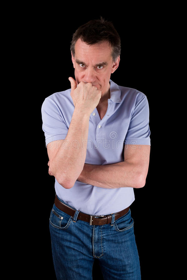 Angry Frowning Man Glaring over Hand on Chin stock photo