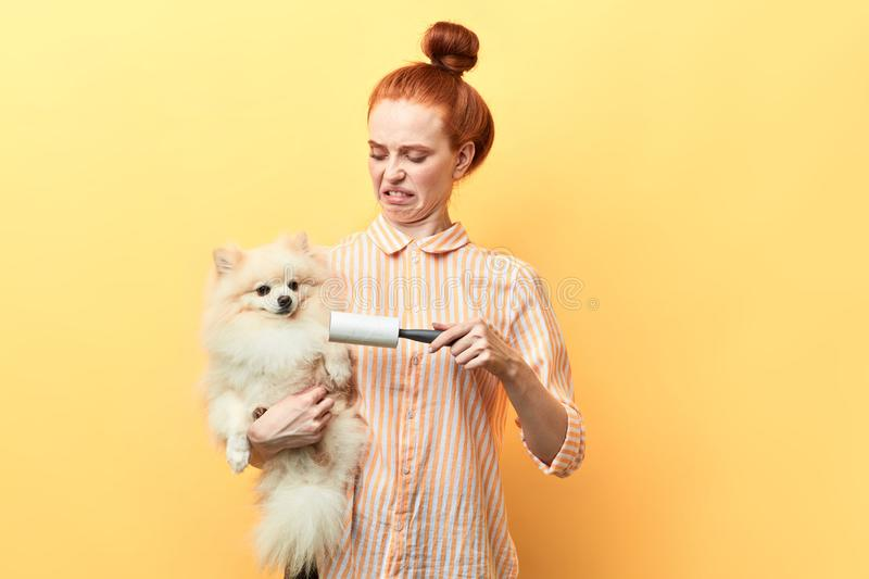 Angry frustrated girl isn`t satisfied with taking care of pets royalty free stock photos