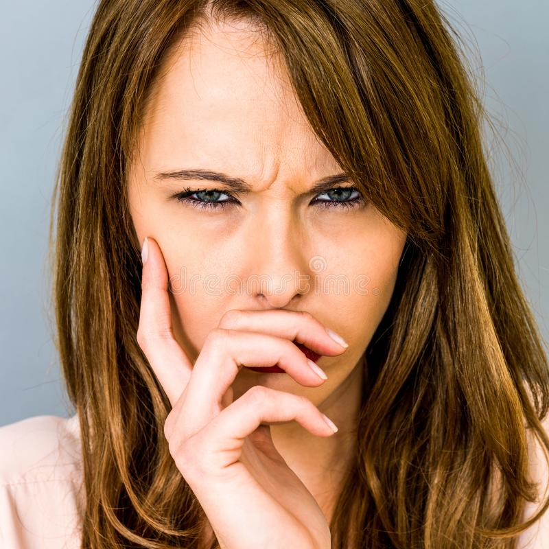 Angry Frustrated Young Woman Frowning In Disagreement stock photos