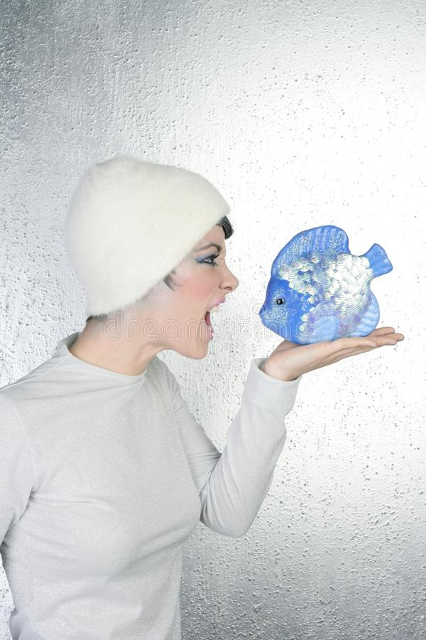 Angry futuristic fashion woman shout to blue fish royalty free stock photos