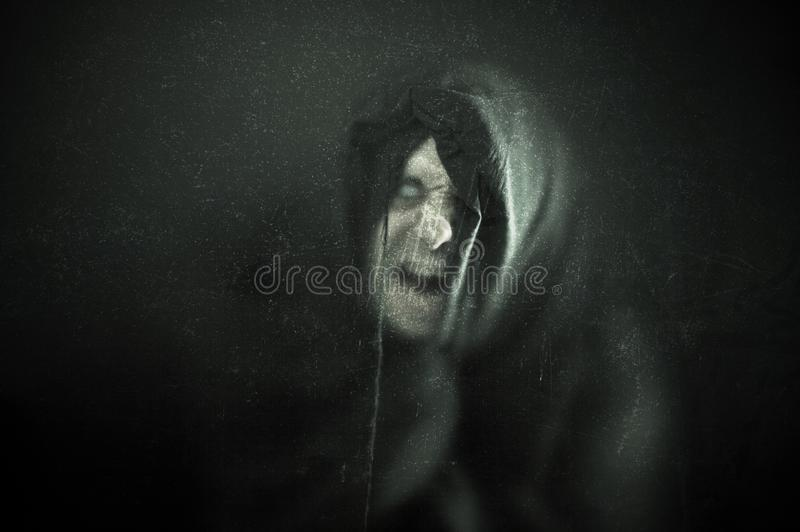 Angry ghost in the dark. Angry ghost figure in the dark royalty free stock images