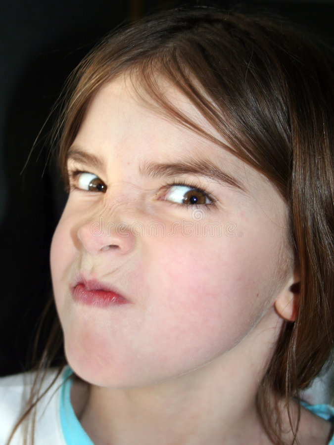Angry Girl. Young Child making an Angry Face stock photography