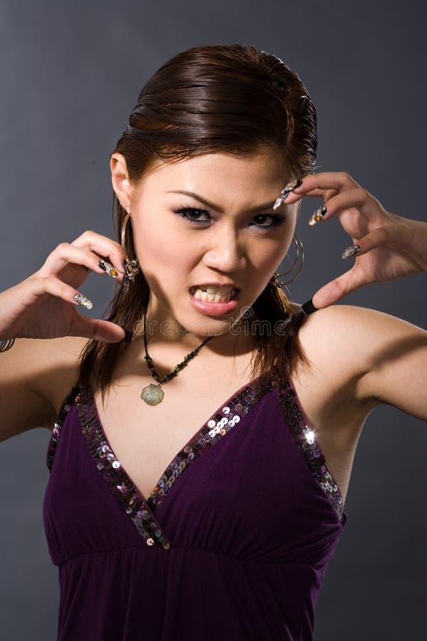 Angry girl growl stock photos